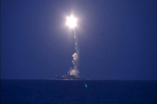 A still image taken from footage released by Russia's Defence Ministry on October 7, 2015, shows a Russian warship firing a rocket in the Caspian Sea. The Russian defence ministry said on Wednesday that 26 rockets fired by its warships earlier in the day had struck targets associated with Islamic State and Al-Nusra, the Interfax news agency reported. REUTERS/Ministry of Defence of the Russian Federation/Handout via Reuters TPX IMAGES OF THE DAY ATTENTION EDITORS - THIS IMAGE HAS BEEN SUPPLIED BY A THIRD PARTY. IT IS DISTRIBUTED, EXACTLY AS RECEIVED BY REUTERS, AS A SERVICE TO CLIENTS. REUTERS IS UNABLE TO INDEPENDENTLY VERIFY THE AUTHENTICITY, CONTENT, LOCATION OR DATE OF THIS IMAGE. FOR EDITORIAL USE ONLY. NOT FOR SALE FOR MARKETING OR ADVERTISING CAMPAIGNS. NO SALES. NO ARCHIVES